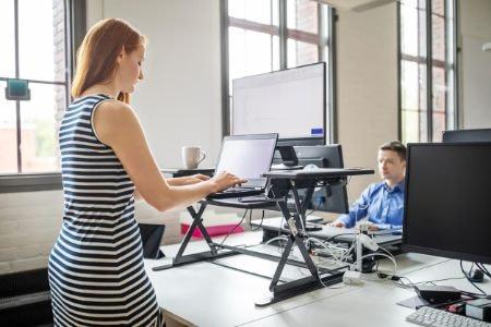 Choose Between a Full-Standing Desk or a Standing Desk Converter