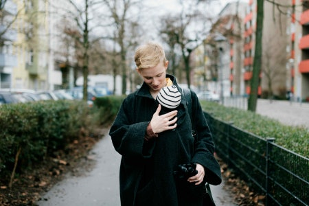 Pick a Coat With a Carrying Pouch to Bond With Baby As You Walk