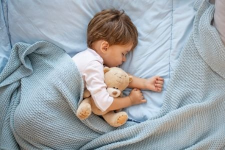 Use the Age Advice and Your Instinct to Decide Whether Your Child Is Old Enough for a Bed